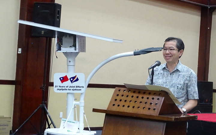 Taiwan Ambassador Jeffrey Hsiao during the handover of 100 solar streetlights, batteries and a grant
