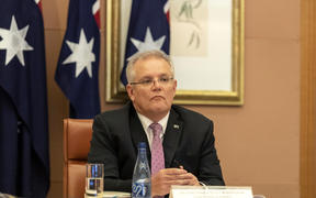 Australian Prime Minister Scott Morrison attends a video conference with G20 leaders to discuss the COVID-19 coronavirus, at the Parliament House in Canberra on March 26, 2020.