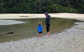 A mum and toddler in the Abel Tasman National Park where it's expected more Kiwis will get the chance to see.