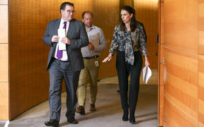 Prime Minister Jacinda Ardern and Finance Minister Grant Robertson arrive at a press conference at Parliament.