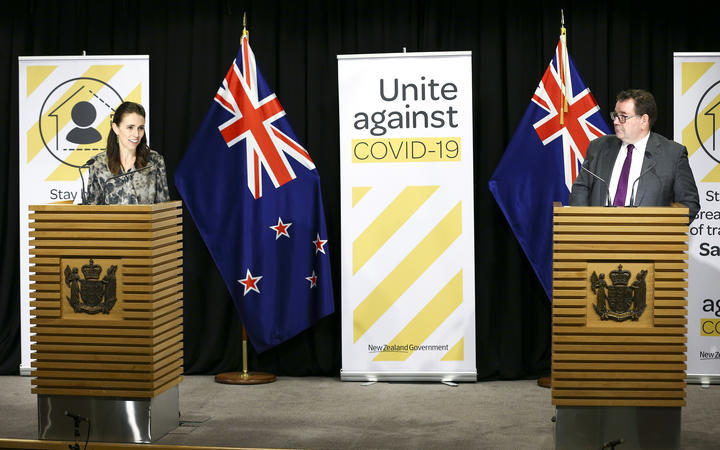 Prime Minister Jacinda Ardern and Finance Minister Grant Robertson speak to media during a press conference at Parliament on April 02, 2020.