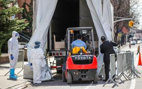 A refrigerated try with a frigurific truck is used as a morgue at The Brooklyn Hospital Center in New York during the coronavirus Covid-19 pandemic in the United States.