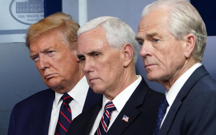 US President Donald Trump, US Vice President Mike Pence and Director of Tra.de and Manufacturing Policy Peter Navarro look on during the April 2 briefing on the novel coronavirus