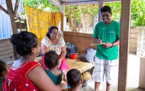 Child Fund NZ staff in Kiribati visit a family in Betio, Tarawa.