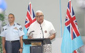 Fiji's PM, Frank Bainmarama gives the a Covid-19 update, with Police Commissioner Sitiveni Qiliho behind him
