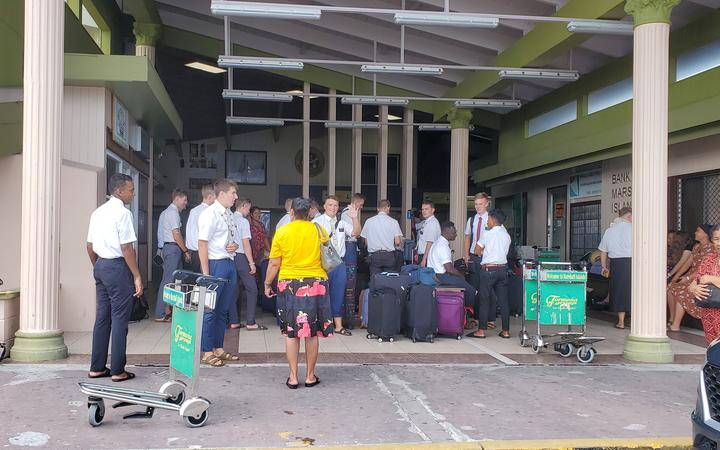 LDS church missionaries are joined by well-wishers at Amata Kabua International Airport in Majuro