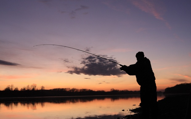 A file photo shows a man casting his line into a river.