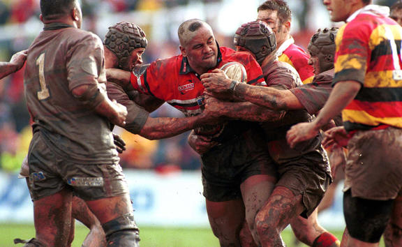 New Zealand Counties Manukau Rugby union player, Jonah Lomu getting tackled during a match, npc rugby 1999