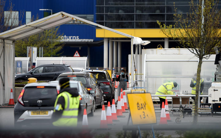 A long queue of cars wait at a coronavirus  drive-through testing station set up at the for NHS staff in London.