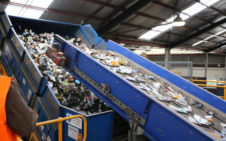 Fresh off the truck, recycling going onto the first conveyor belts to begin the sorting process at Oji.