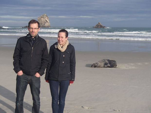 Jon Waters and catherine Collins with a New Zealand sealion at Sandfly Bay on the Otago peninsula