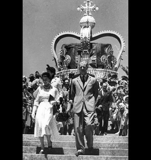 A huge crown dwarfs the royal couple as they walk down the steps in front of Nelson Cathedral January Courtesy Archives New Zealand Resize