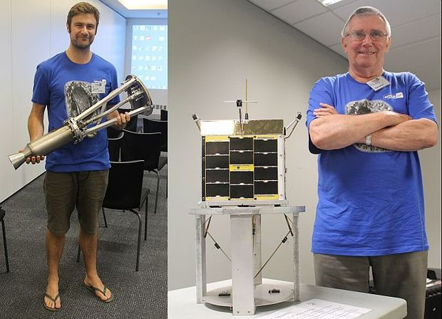 Ian Finer with his rocket engine and  Fred Kennedy with a model of Kiwisat, a homegrown satellite.