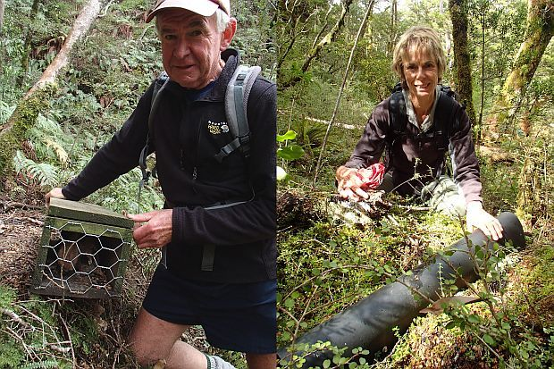 Stu Thorne with a trap that has caught a stoat, and Gillian Crombie with a tracking tunnel