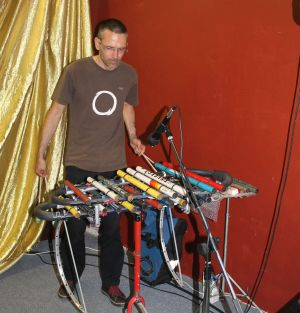 Adrian Croucher playing his cyclical tubaphone
