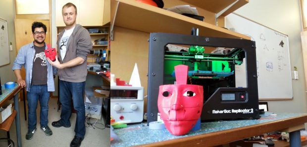 Eduardo Sandoval and Tim Pomroy with the robot's face, and the 3D printer