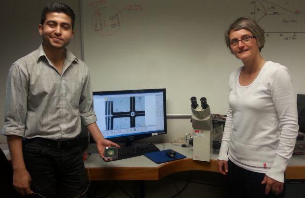 Steven Banerjee holding a prototype device with Stefanie Gutschmidt