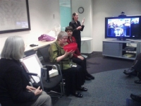 Robyn Hunt admires her farewell gift from the HRC as Chief Commissioner Ros Noonan (foreground) looks on