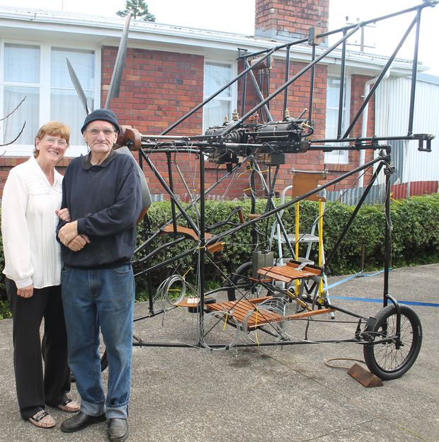 Flight Ivan Mudrovcich and his wife Janet in front of the frame of the Pearse aircraft reproduction photo Lisa Thompson