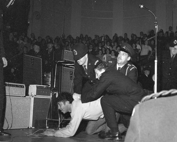 Fans and police during Beatles concert at Wellington Town Hall The Dominion Post Collection Alexander Turnbull Library crop