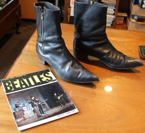 Beatle Boots and show programme from the collection of Garry Bell Auckland photo RNZ Sam Wicks cropped
