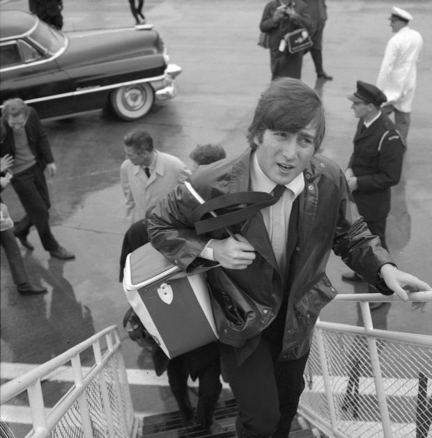 Beatle John Lennon boarding aircraft after visit to Wellington The Dominion Post Collection Alexander Turnbull Library