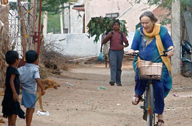 Jean Watson on her bicycle in India