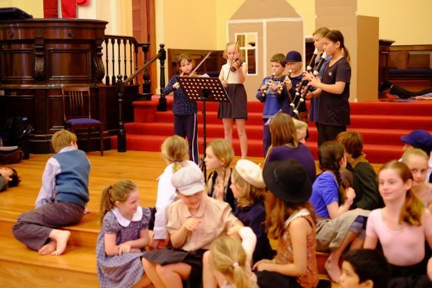 Cast watches orchestra from Kelburn Normal School image supplied