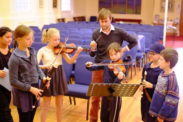 Conductor Robert legg with chamber orchestra from Kelburn Normal School image supplied