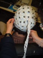 A participant in the study submits to being wired up.