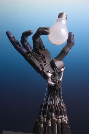 Shadow Dexterous Robot Hand holding a lightbulb CC BY SA Richard Greenhill and Hugo Elias