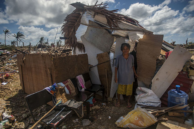 Philippines Nov A Guiuan woman stands outside of her makeshift shack in the aftermath of Super Typhoon Haiyan PD USA Defense