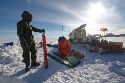 Physicists measuring the thickness of Antarctic sea ice