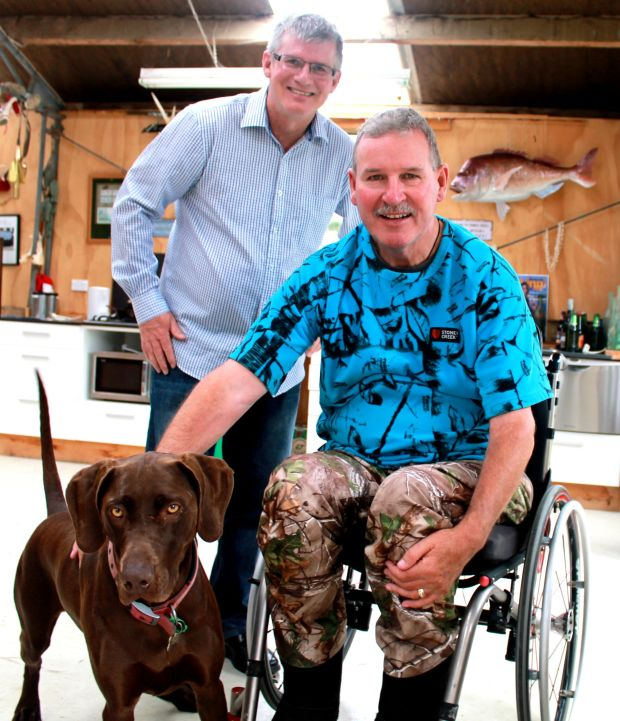 Geoff Penrose Graeme Sinclair in his man cave with his dog
