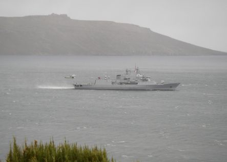 The Navy frigate Te Kaha approaching Campbell Island.