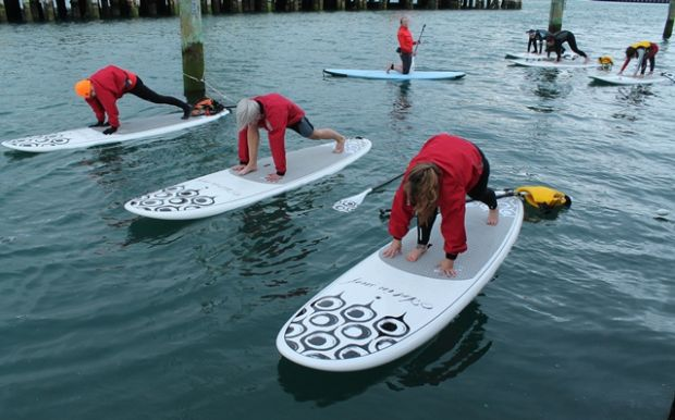 Yoga standing up on paddle boards