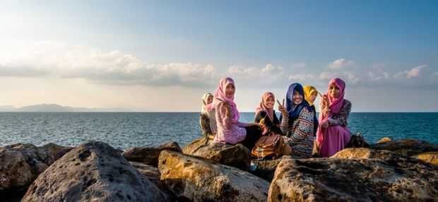 Young women on a new sea wall Banda Aceh