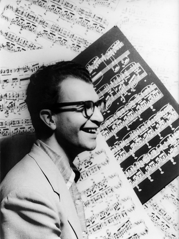 Dave Brubeck with sheet music as backdrop October PD