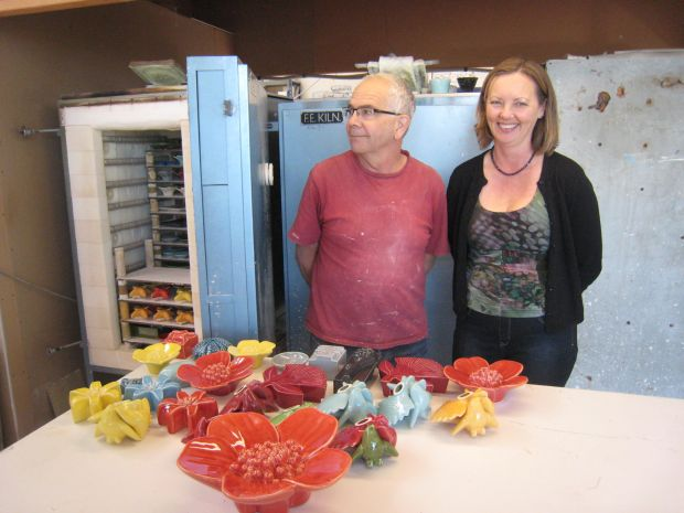 Bob and Alison Steiner in front of a batch of newly fired ceramics at their Avondale pottery studio