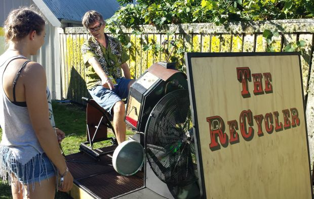 Bryan Crump has a go at recycling at WOMAD Taranaki Photo RNZ