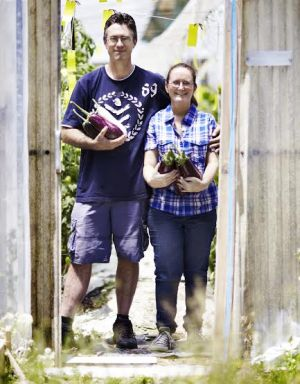 Anthony and Angela outside their greenhouses
