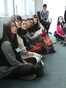 The Mandarin Language Assistants listen to speeches cropped