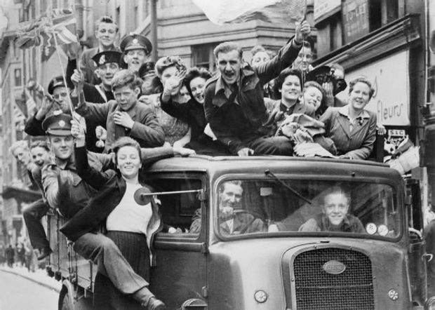 VE Day Celebrations in London May A truck of revellers passing through the Strand London