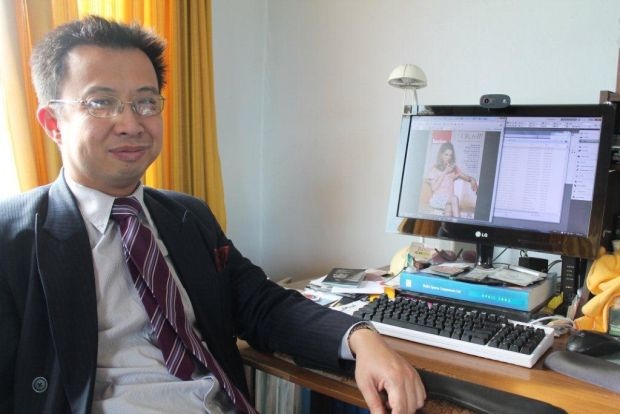 Jack yan at his desk hub for the Lucire Fashion Magazine