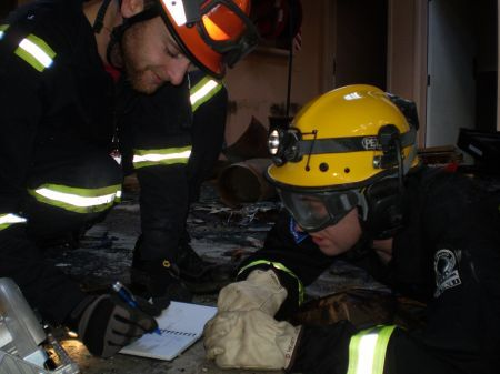 USAR team make notes on a rescue
