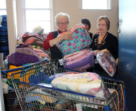 Knitting Natter Aileen and Leena loading the trolley at Kidz First small
