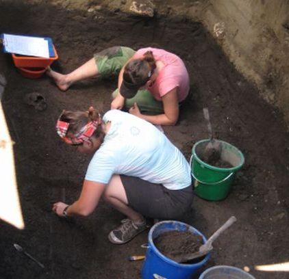 hallie Buckley and Rebecca Kinaston excavating Lapita cemetery