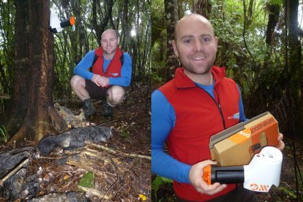 Robbie Greig with possums killed by a self-setting trap in just one week, and holding the Henry possum trap