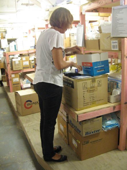 Med Aid April Volunteer Nurse Jane sorting surgical supplies small