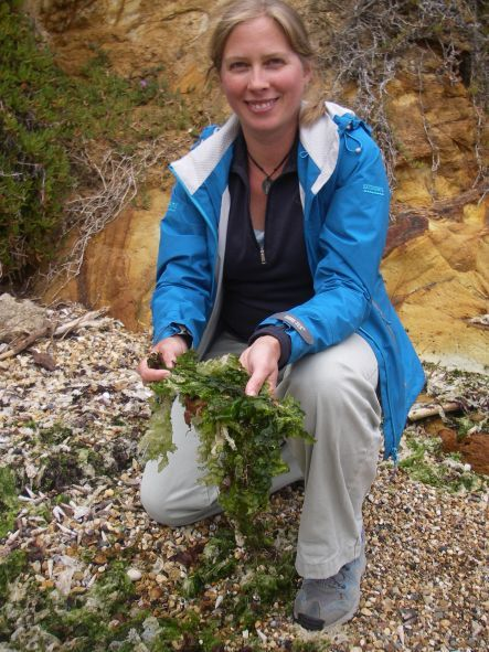 Candida Savage holding the green seaweed sea lettuce